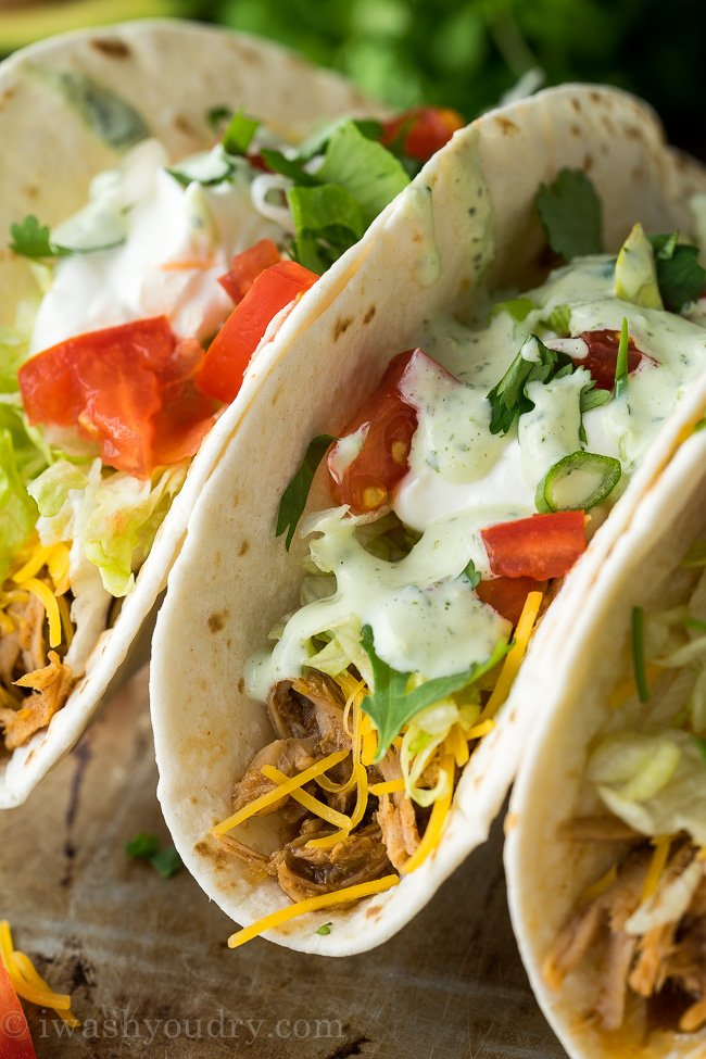 These Slow Cooker Sweet Pulled Pork Tacos are my family's favorite easy weeknight dinner!
