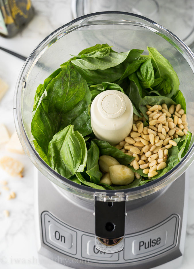 This is the EASIEST Fresh Basil Pesto Recipe! Just combine the ingredients in a food processor and watch the magic happen!
