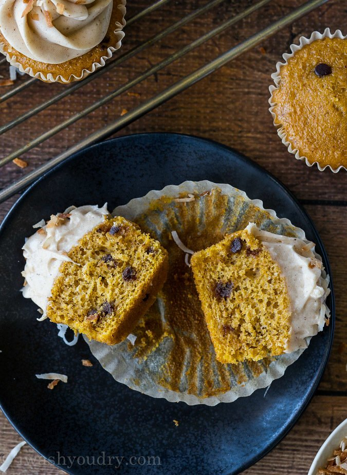 These Pumpkin Chip Cupcakes with Spiced Cream Cheese Frosting are insanely delicious and so easy! They start with a box cake mix and I can't wait to make them again!