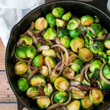 Render the bacon until it's almost crisp, then cook the Brussels Sprouts and onions in the bacon grease until they are caramelized and tender.