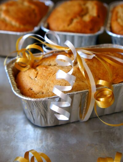 A small loaf of Eggnog Bread wrapped with a ribbon
