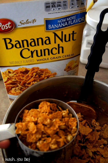 A measuring cup of Banana Nut Crunch over a bowl of batter