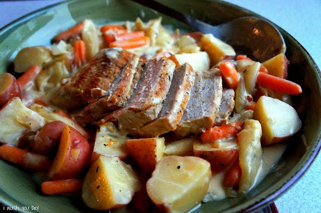 Creamy Garlic Pot Roast displayed on a plate surrounded with potatoes and carrots