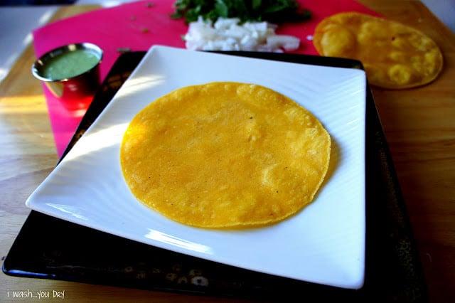 A corn tortilla displayed on a plate