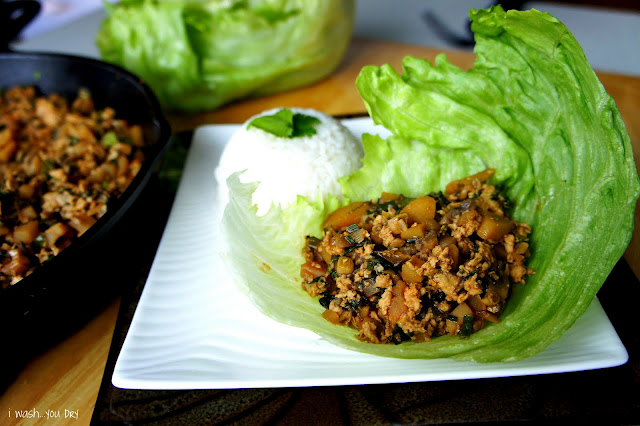 Chinese chicken resting on a layer of lettuce on a plate