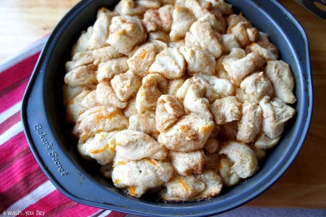 Baked Orange Cinnamon Pull Aparts in a round baking pan