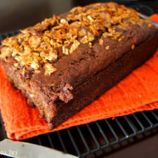 A loaf of Banana Nutella Crunch Bread on a cooling rack