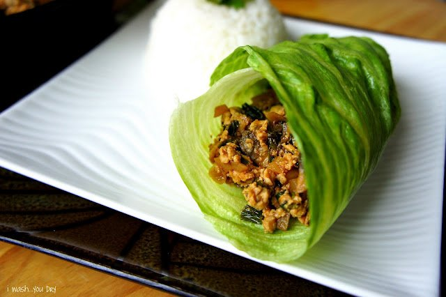 Chinese Chicken Lettuce Wraps displayed on a plate with a side of rice