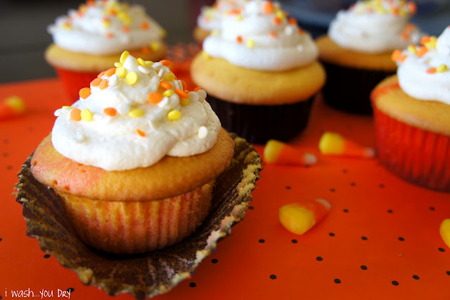 A close up of a cupcake wrapper being removed from a Candy Corn Cupcake