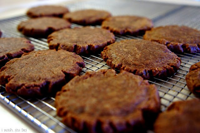 A close ups of chocolate cookies on a cooling rack