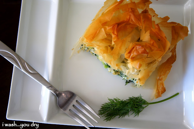 Pie Style Spanakopita displayed on a plate next to a fork