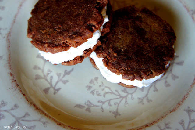 Two cookie sandwiches displayed on a plate
