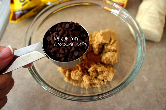 A measuring cup of chocolate chips above a bowl of other needed ingredients to make a Chocolate Chip Sticky Bun Ring