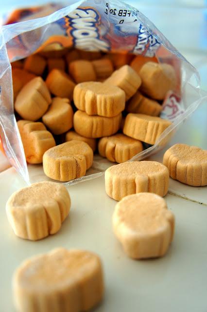A close up of an open bag of pumpkin marshmallows
