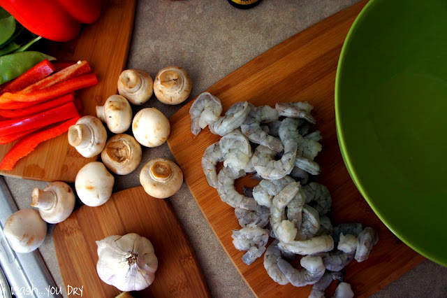 A display of needed ingredients to make Kung Pao Shrimp Lo Mein: peppers, mushroom, garlic, shrimp,