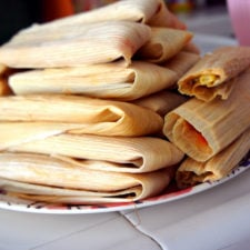 A pile of tamales stacked on a plate