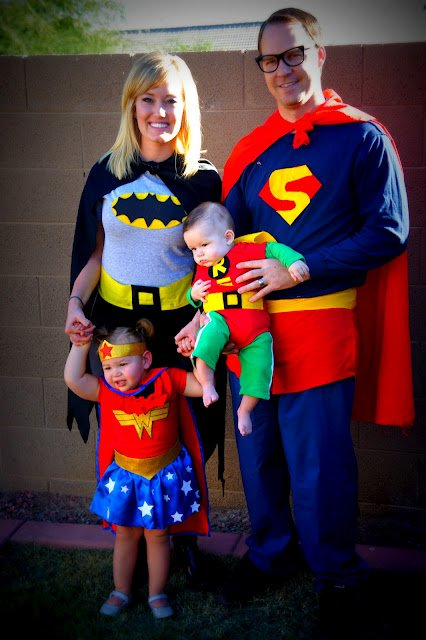 A family dressed up like super heroes