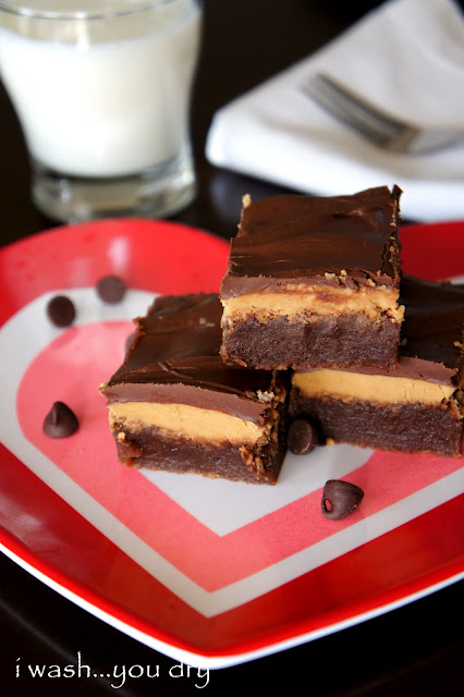 A chocolate brownies on a plate, made with Peanut butter and Fudge