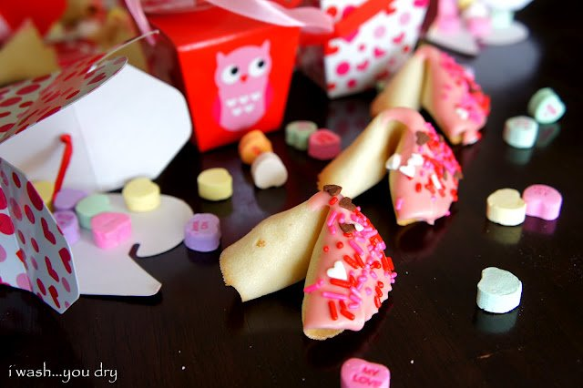 A homemade fortune cookie decorated with pink and red, Valentine\'s Day theme