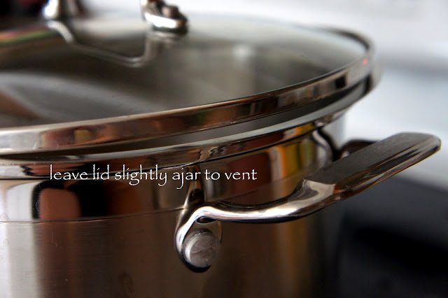 """A close up of a lid on a pot with the instructions \""""leave lid slightly ajar to vent\"""" on it"""