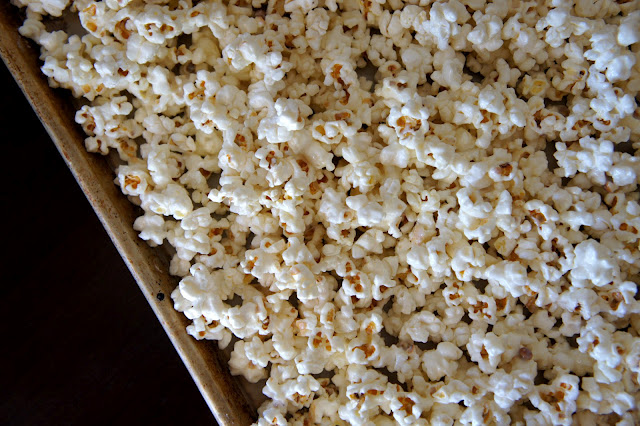 A close up of popcorn in a baking pan