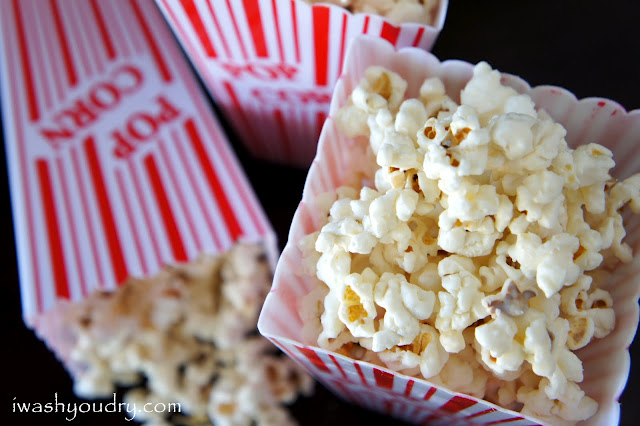 A close up of popcorn displayed in a popcorn container
