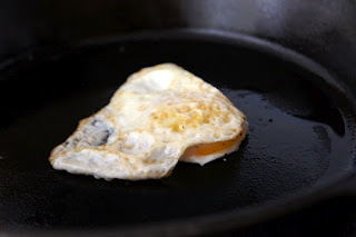 A close up of a fried egg in a skillet