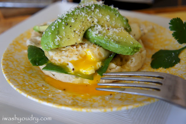 A close up of a plate with an Open Faced Egg and Avocado Sandwich on it