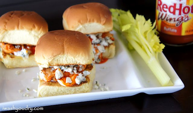 A close upon sliders on a plate filled with buffalo chicken and blue cheese