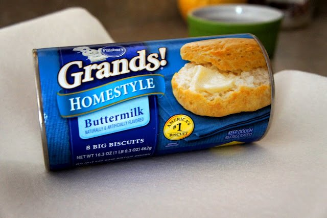 "A close up of a tube of refrigerator biscuits labeled, ""Grands! Homestyle Buttermilk\"""