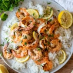 This Grilled Lemon Cilantro Shrimp Recipe is perfectly seasoned shrimp that are grilled up in minutes for a light and fresh Summer dinner.