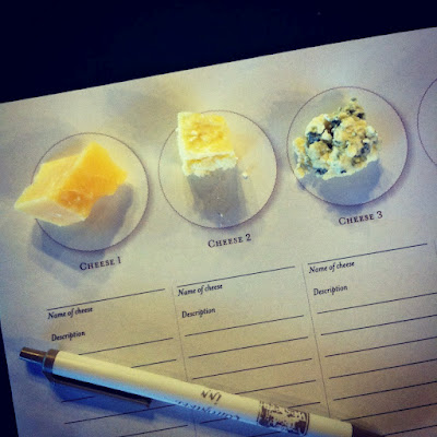 A paper with 3 different types of cheese samples and space to write the cheese name and descriptions below each