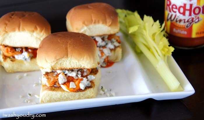 A close up of a couple of Buffalo Chicken and Blue Cheese Sliders on a plate