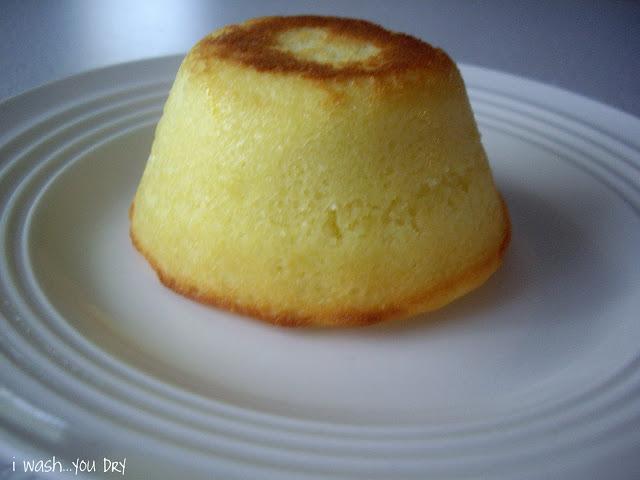 An upside down mini cake on a plate.