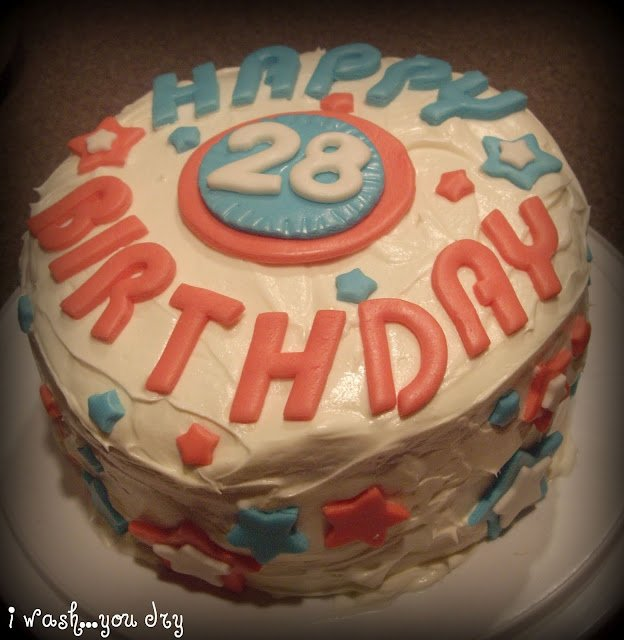 """A birthday cake with \""""Happy 28 Birthday\"""" written on top."""