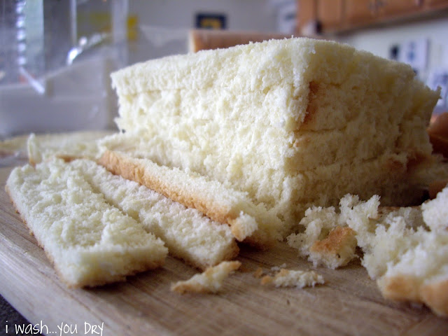 A stack of bread slices with the crust cut off.