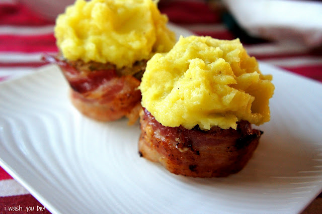 A close up sweet potato topped bacon lined meatloaf cup cakes on a plate.