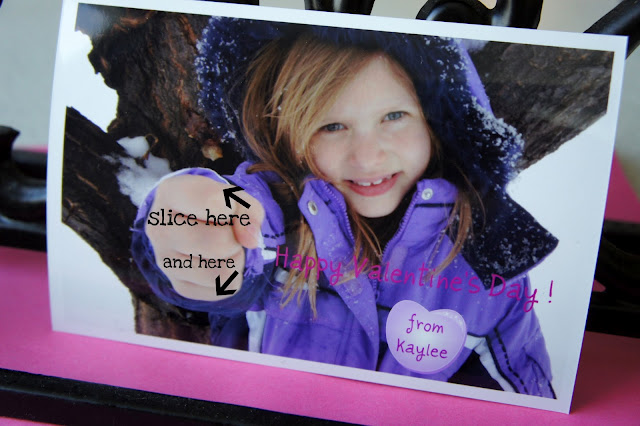 A picture of a little girl holding her hand out with instructions on where to slice the picture.