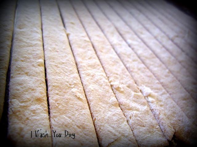 A close up of strips of pretzel dough.