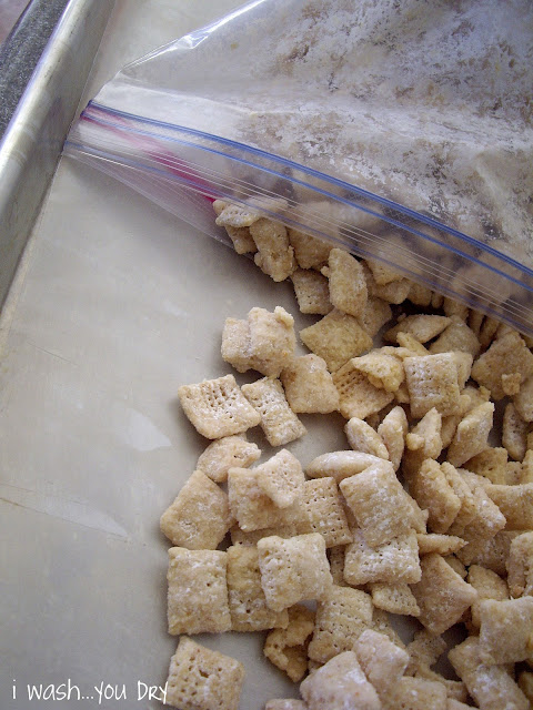 Cereal being dumped onto a baking sheet from a ziplock bag.