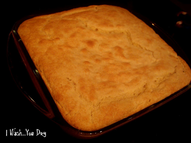 A glass pan of a bread topped dish of food.