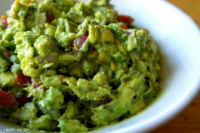 A close up of guacamole in a bowl.