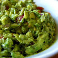 A close up of a bowl of guacamole.