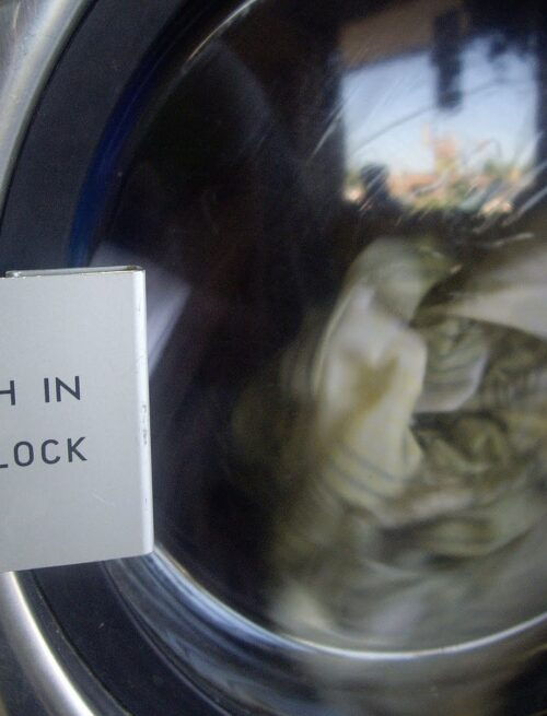 A close up of laundry washing in a washing machine.