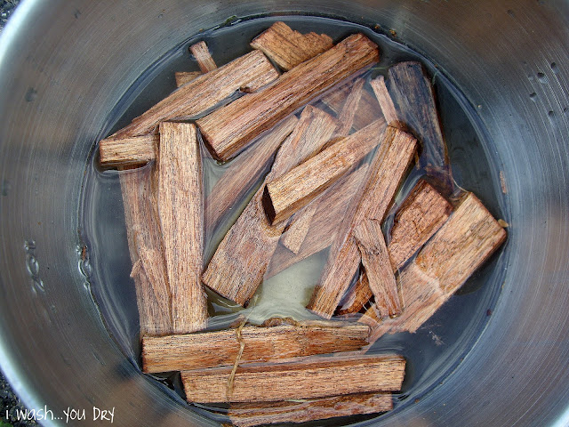 A pot with mesquite sticks soaking in water.