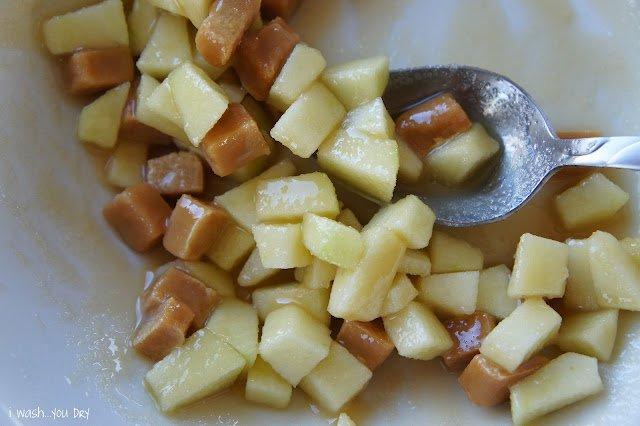 Chopped apples, chopped caramel candies mixed together in a bowl.
