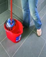 A mop in a bucket.