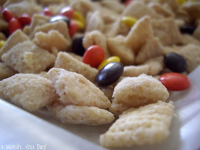 A close up of cereal and Reeses Pieces.