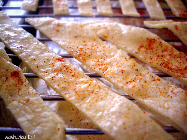 A close up of tortilla chips sprinkled with seasoning.