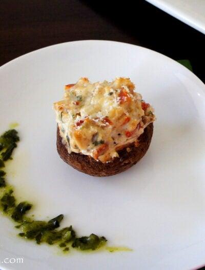 A stuffed mushroom displayed on a plate
